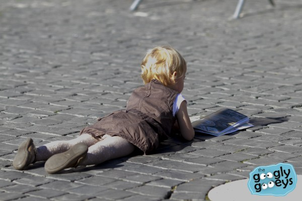 Child lying down at the St. Peter's Square