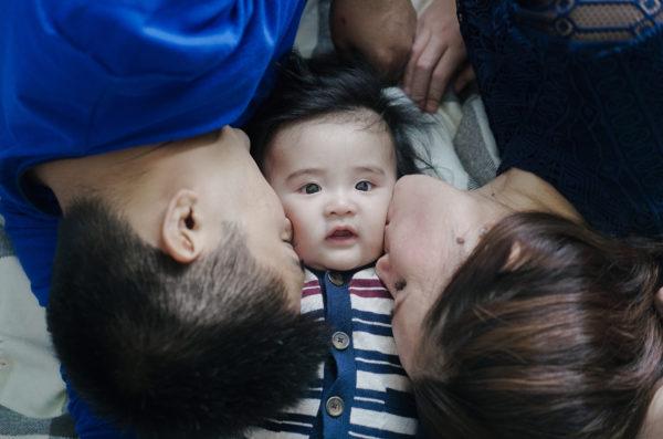 Mommy & Daddy Kissing Riley