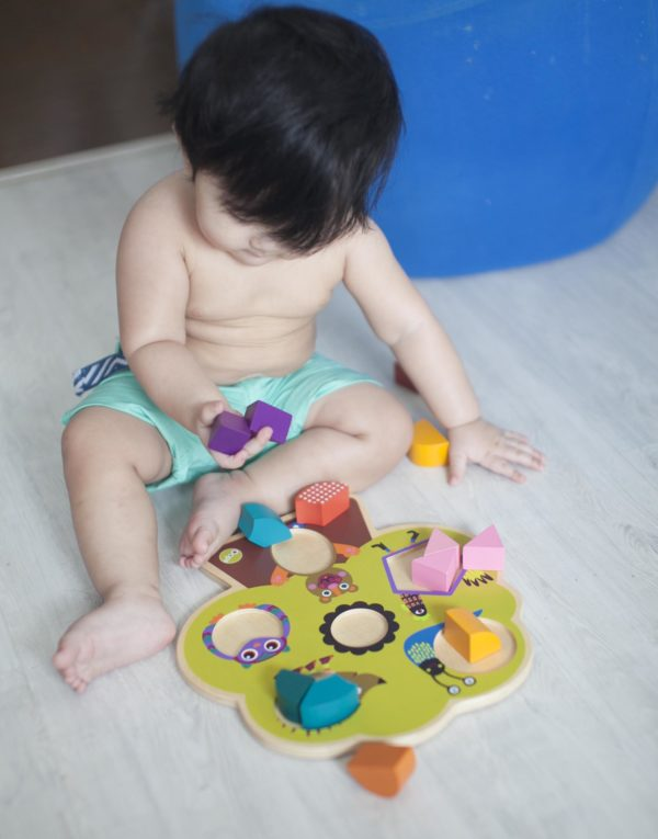 Riley with Wooden Toys
